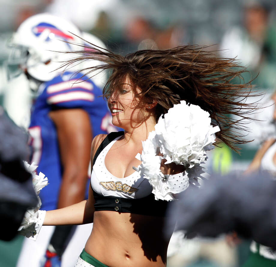 New York Jets' cheerleaders perform during an NFL football game between the Jets and Buffalo Bills at MetLife stadium Sunday, Sept. 9, 2012, in East Rutherford, N.J. (AP Photo/Mel Evans) Photo: Mel Evans, Associated Press / AP