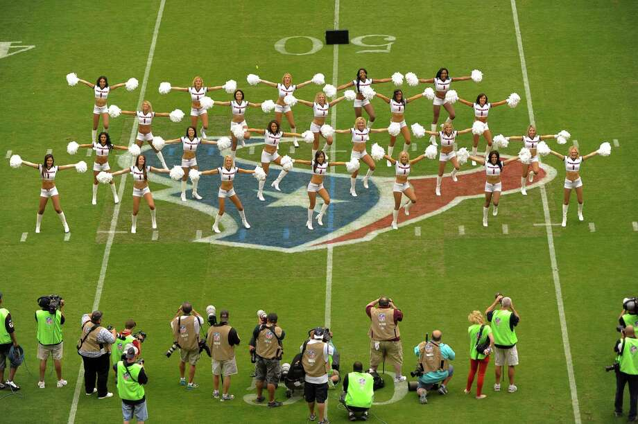 Houston Texans cheerleaders perform before an NFL football game against the Miami Dolphins, Sunday, Sept. 9, 2012, in Houston. (AP Photo/Dave Einsel) Photo: Dave Einsel, Associated Press / FR43584 AP