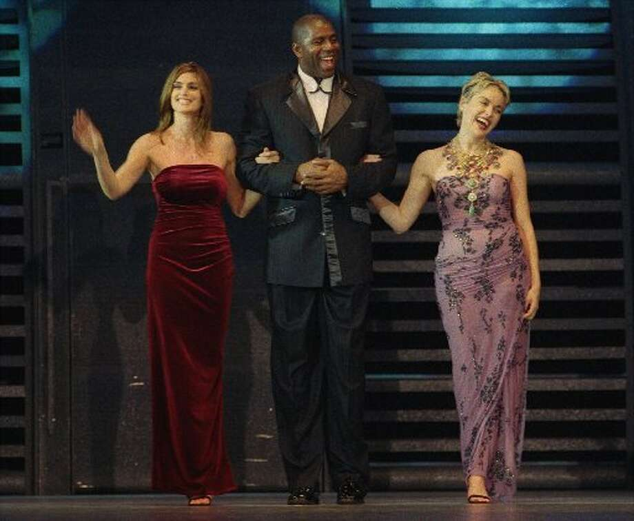 Cindy Crawford, Magic Johnson, and Sharon Stone hosted the Macy's annual Passport show in 1999. (Liz Hafalia  / Macy\'s Passport)