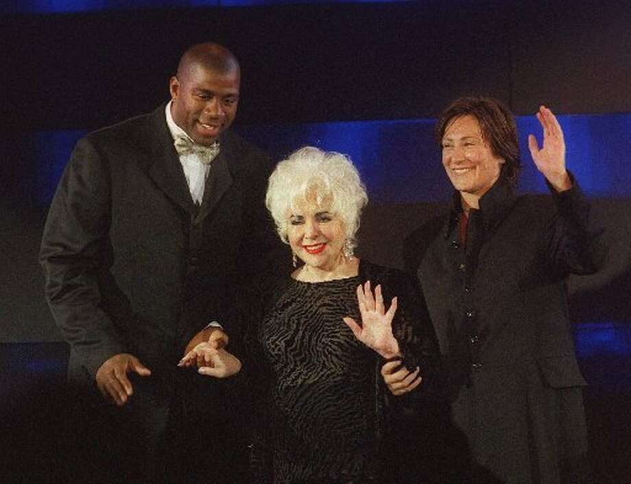 "Magic Johnson, Liz Taylor, and M.A.C. Aids co-chair K.D. Lang host Macy's Passport's ""Different Together"" at Fort Mason in 1998. (Liz Hafalia / Macy\'s Passport)"