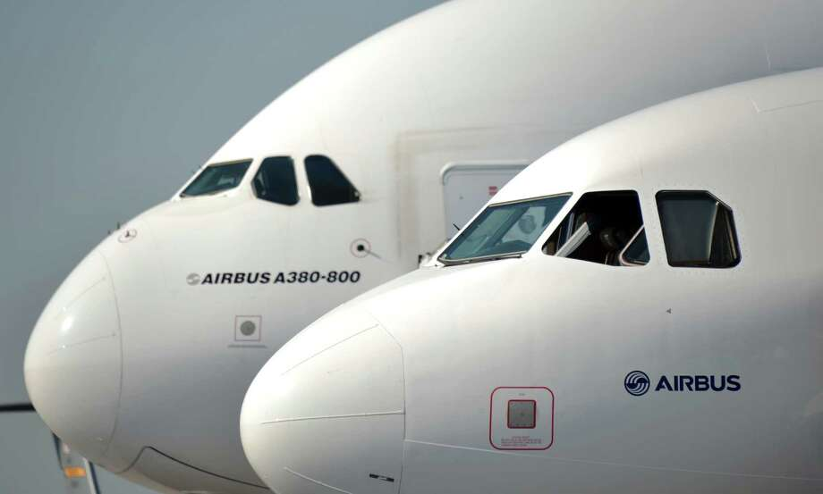 The frontend of an Airbus 380-800 (L) and an Airbus 320 are pictured at the International Air Show ILA in Schoenefeld, near Berlin on September 11, 2012.The 2012 international air fair runs from September 11 until 16, 2012.  AFP PHOTO / JOHANNES EISELE        (Photo credit should read JOHANNES EISELE/AFP/GettyImages) Photo: JOHANNES EISELE, AFP/Getty Images / 2012 AFP