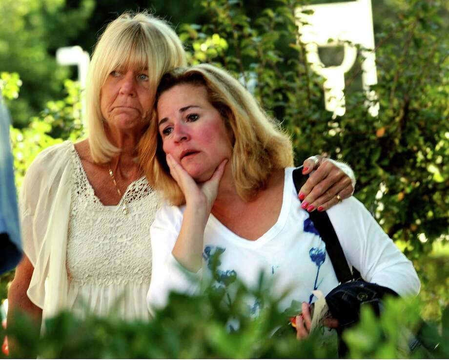Eileen Woodward, of Hampton, and Anne Beluk, of Norwalk, who both work in the Norwalk schools atended the 9/11 Remembrance Ceremony at Norwalk City Hall on Tuesday, Sept. 11, 2012. Photo: Helen Neafsey / Greenwich Time