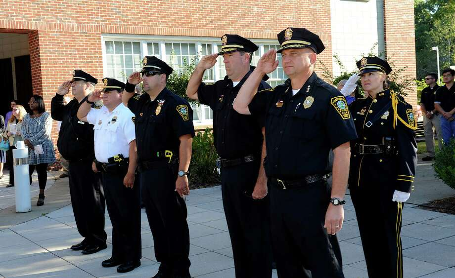 Chief of Police Thomas Kulhawik, right, and others, salute the flag at the 9/11 Remembrance Ceremony at Norwalk City Hall on Tuesday, Sept. 11, 2012. Photo: Helen Neafsey / Greenwich Time