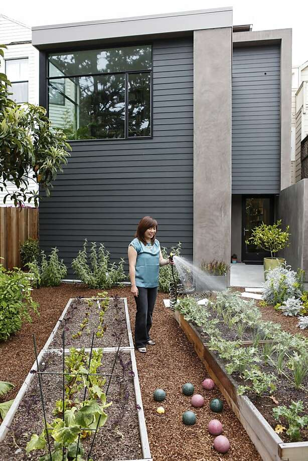 Architect Mimi Chen waters the garden of the Eddie House in S.F.'s Richmond District - the name is a nod to the home's Edwardian bones. The house is included in the home tour. Photo: Russell Yip, The Chronicle