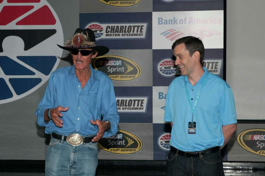 Norris Scott, of Westport, right, is shown here with legendary NASCAR driver Richard Petty. Scott, who grew up in Redding, is vice president of partnership marketing and business solutions for the National Association for Stock Car Auto Racing, also known as NASCAR. Photo: Contributed Photo