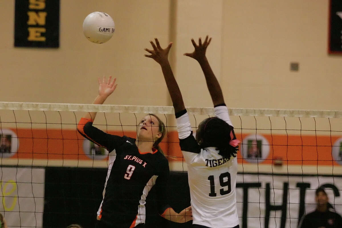 St. Agnes' Sakile Simmons, right, has been a force at the net for the Tigers, who are out to recapture the district title this fall.