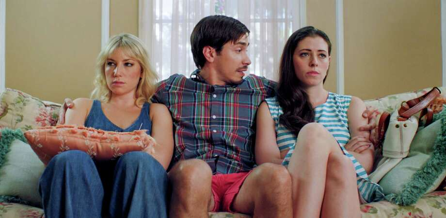 "Justin Long (center) plays the gay best bud of roomies Katie (Ari Graynor, left) and Lauren (Lauren Miller) in ""For A Good Time, Call ... ."" Photo: Focus Features / Focus Features"