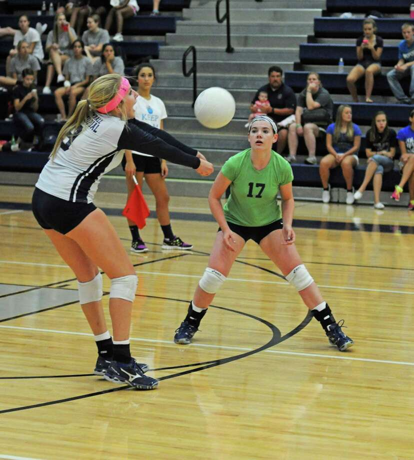 Tomball Memorial junior Keleigh Carver, left, junior libero Kelsey Lambert, No. 17, and the Wildcats host Spring Woods Friday. Photo: L. Scott Hainline / The Chronicle