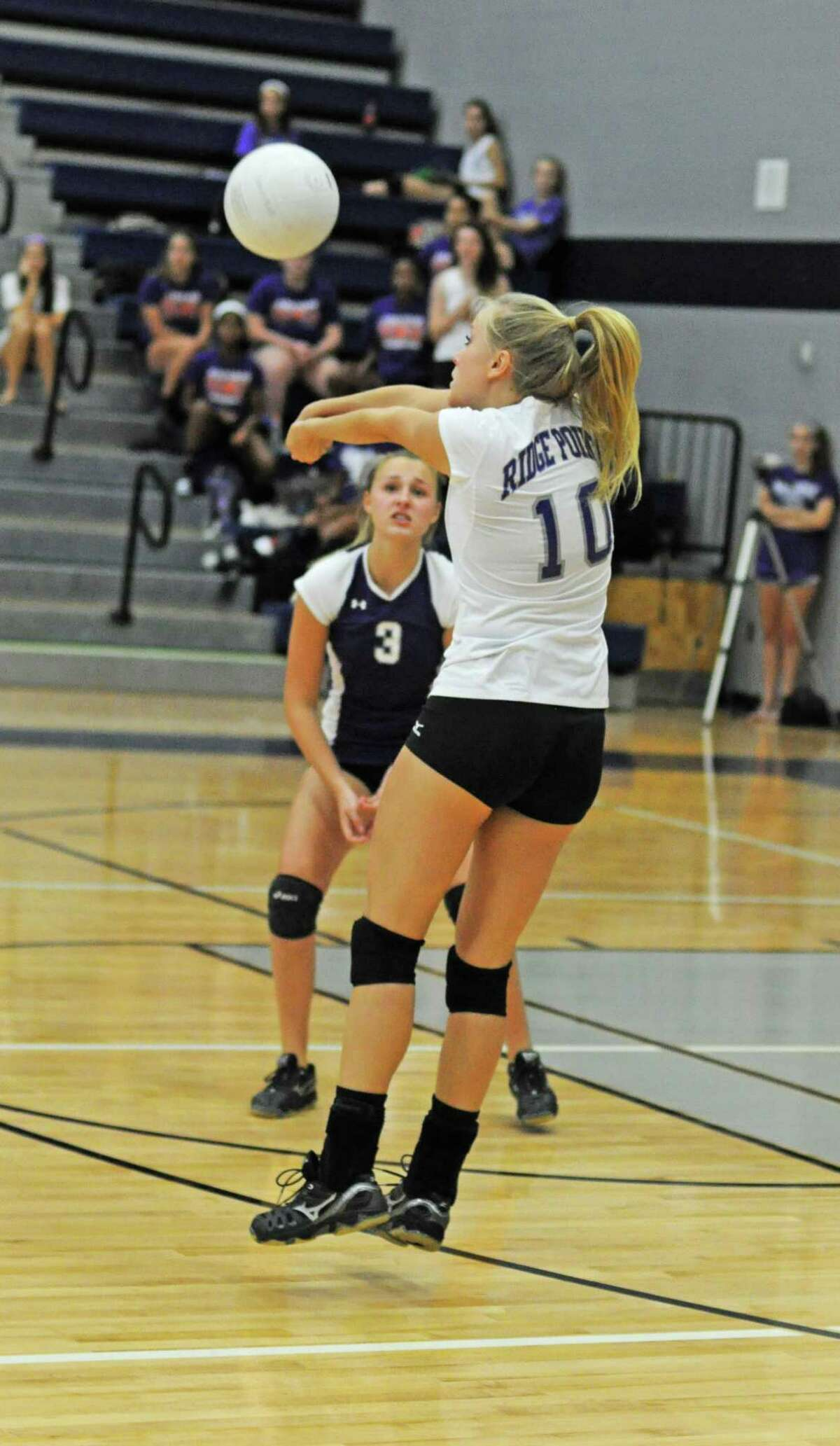 Ridge Point senior Vallen Vaughan (10) and sophomore libero Avery Condrey (3) on 9-7-12 in a District 22-4A volleyball opener at Tomball Memorial. Ridge Point defeated Tomball Memorial 25-22, 29-27, 22-25, 12-25, 15-10.