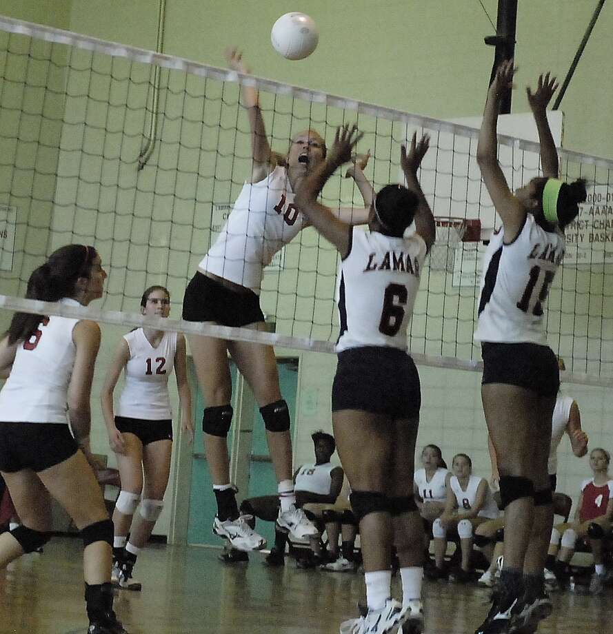 St. John's outside hitter Jane Labanowski, No. 10, scores a point over Lamar with teammates Kate Bres, No. 6, and Caroline Labanowski, No. 12, behind her as the Redskins' Kaelen Temple, No. 6, and Alexa Moore, No. 15, defend at the net. Photo:  Tony Bullard 2012 / © Tony Bullard & the Houston Chronicle