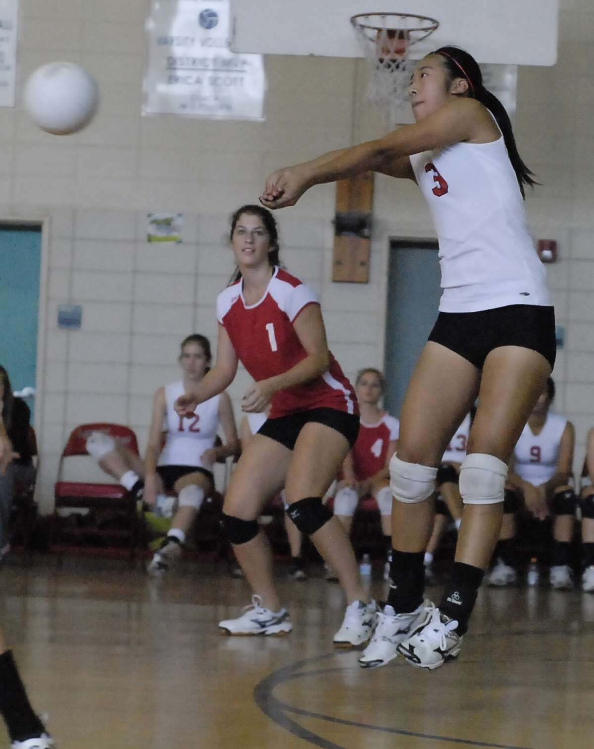 St. John's libero Lauren Resnick, No. 1, and her teammate Stephanie Guo, No. 3, defend the ball during their game at Lamar last month.