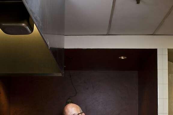 Chef Cal Stamenov cuts meat at Marinus restaurant at Bernardus Lodge in Carmel Village, Calif., Friday, September 7, 2012.