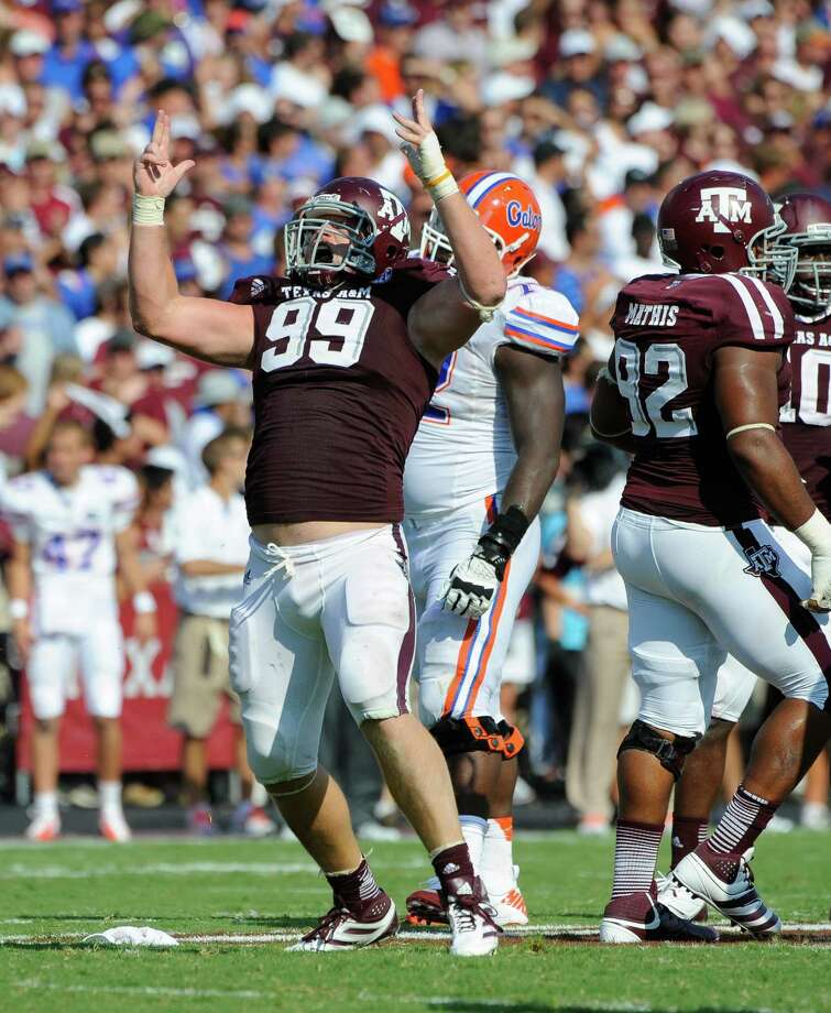 Texas A&M's Spencer Nealy (left) reacts after recording one of his two sacks in Saturday's 20-17 SEC-opening loss to Florida. The Aggies were happy with how they adjusted to new coach Kevin Sumlin's 4-3 scheme. Photo: Dave Einsel, Associated Press / FR43584 AP