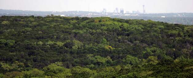 The Tower of the Americas and downtown San Antonio can be seen Thursday April 7, 2005 from the soon-to-be-open Government Canyon State Natural Area. Photo: WILLIAM LUTHER, SAN ANTONIO EXPRESS-NEWS / SAN ANTONIO EXPRESS-NEWS