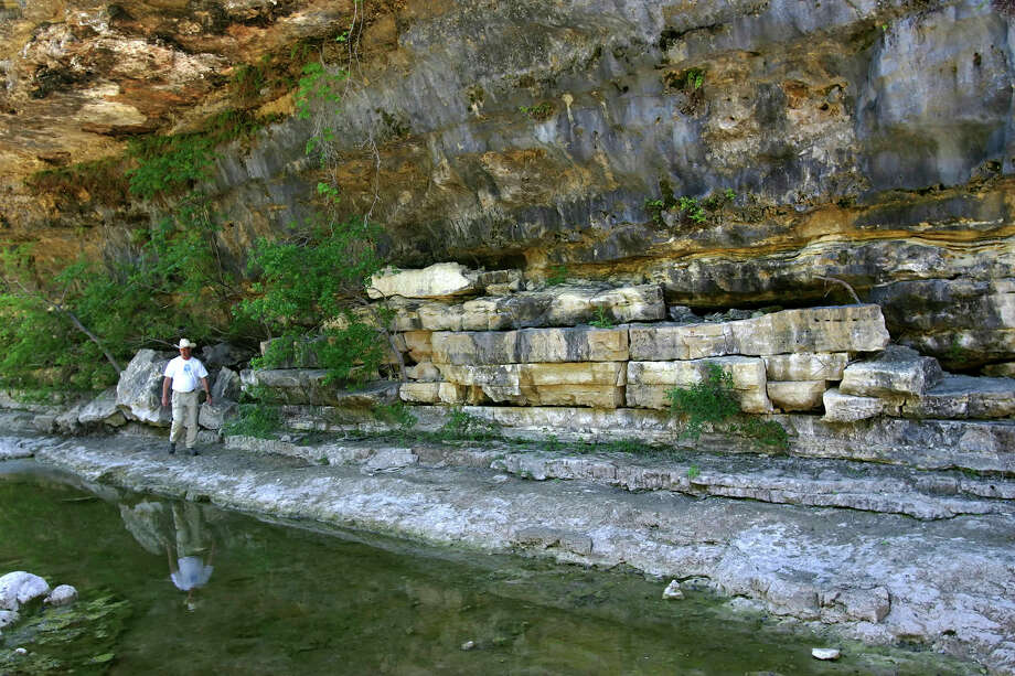 Chief interpreter John Koepke walks under a ledge at Government Canyon State Natural Area in San Antonio April 7, 2005.  Photo: WILLIAM LUTHER, SAN ANTONIO EXPRESS-NEWS / SAN ANTONIO EXPRESS-NEWS