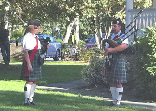"Bagpipers from the Gaelic American Club played ""Amazing Grace"" and other Irish music in memory of the victims of the Sept. 11, 2001, terrorist attacks Tuesday evening on Sherman Green. Photo: Genevieve Reilly / Fairfield Citizen"
