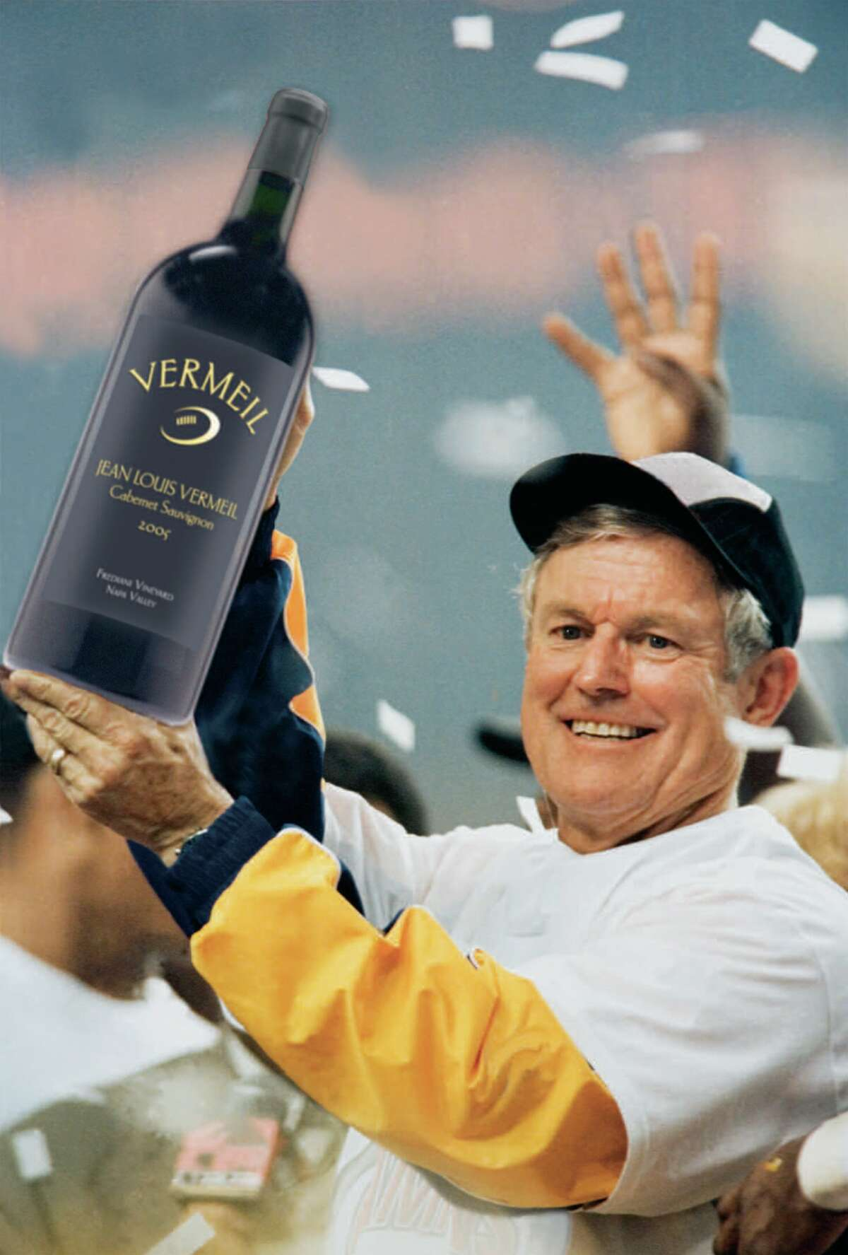 Dick Vermeil hoists a bottle of his Jean Louis Vermeil Cabernet Sauvignon.