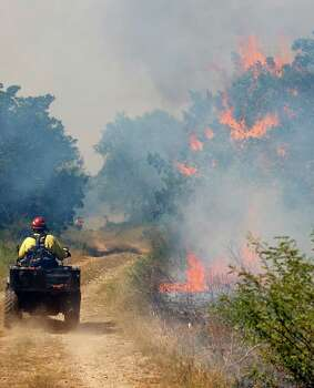 A firefighter makes his way Tue., Sept. 11, 2012 aong a fire line at a prescribed fire in Government Canyon State Natural Area in western Bexar County. Photo: William Luther, San Antonio Express-News / © 2012 San Antonio Express-News