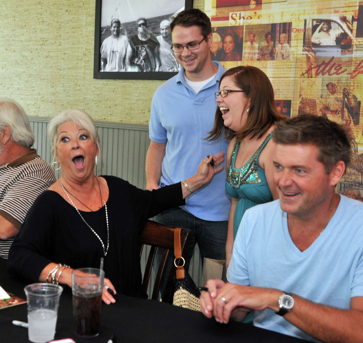 Paula Deen, left, and her son Jamie Deen, right, greet fans at a recent book signing in Savannah, Ga.