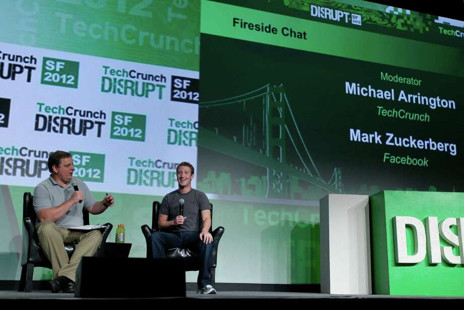 """Facebook CEO Mark Zuckerberg, right, listens to a question from moderator Michael Arrington, left, during a """"fireside chat"""" at a conference organized by technology blog TechCrunch in San Francisco, Tuesday, Sept. 11, 2012.  Zuckerberg gave his first interview since the company's rocky initial public offering in May. (AP Photo/Eric Risberg) Photo: Eric Risberg, Associated Press / AP"""