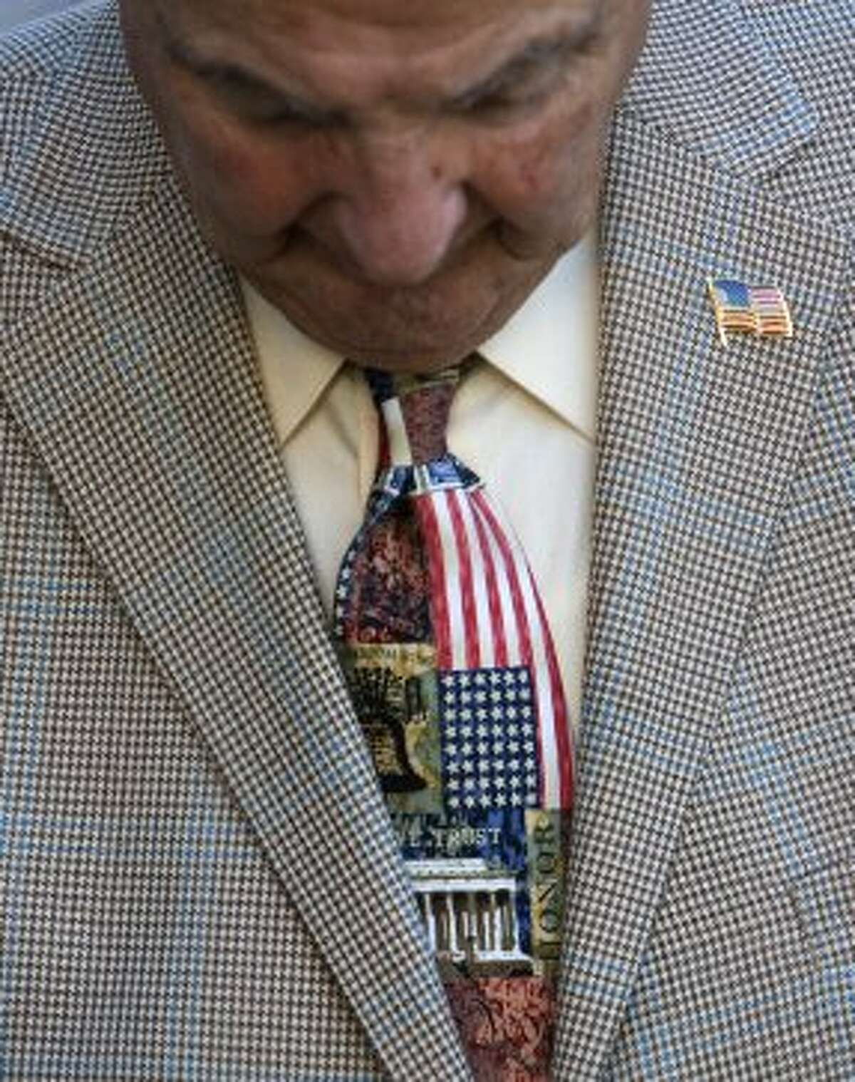 Tony Cucolo looks down before the start of a Sept 11 Commemoration at Lauren's Garden at Market Square Park Tuesday, Sept. 11, 2012, in Houston. The commemoration honored the terrorist attacks on the Twin Towers in New York City on September 11, 2001. (Cody Duty / Houston Chronicle)