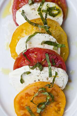 A caprese sale at Cantinetta Luca, named for Fink's son. Photo: Jason Henry, Special To The Chronicle
