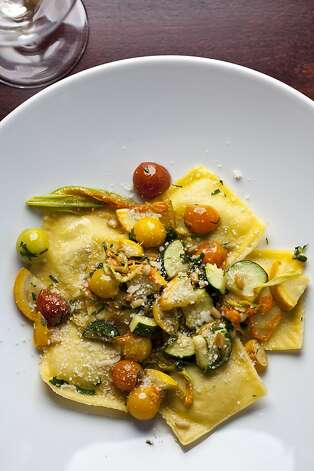Ravioli Estivi with basil and ricotta filling, toybox tomatoes, pine nuts, and squash blossom at Cantinetta Luca, one of David Fink's restaurants, in Carmel, Calif., Friday, September 7, 2012. Photo: Jason Henry, Special To The Chronicle