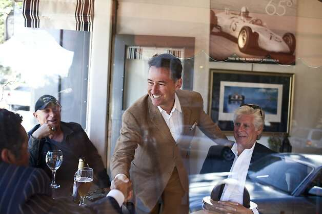 David Fink, founder and chief executive officer of Mirabel Hotel and Restaurant Group, greets friends he saw while walking along Ocean Avenue in Carmel, Calif., Friday, September 7, 2012. Photo: Jason Henry, Special To The Chronicle
