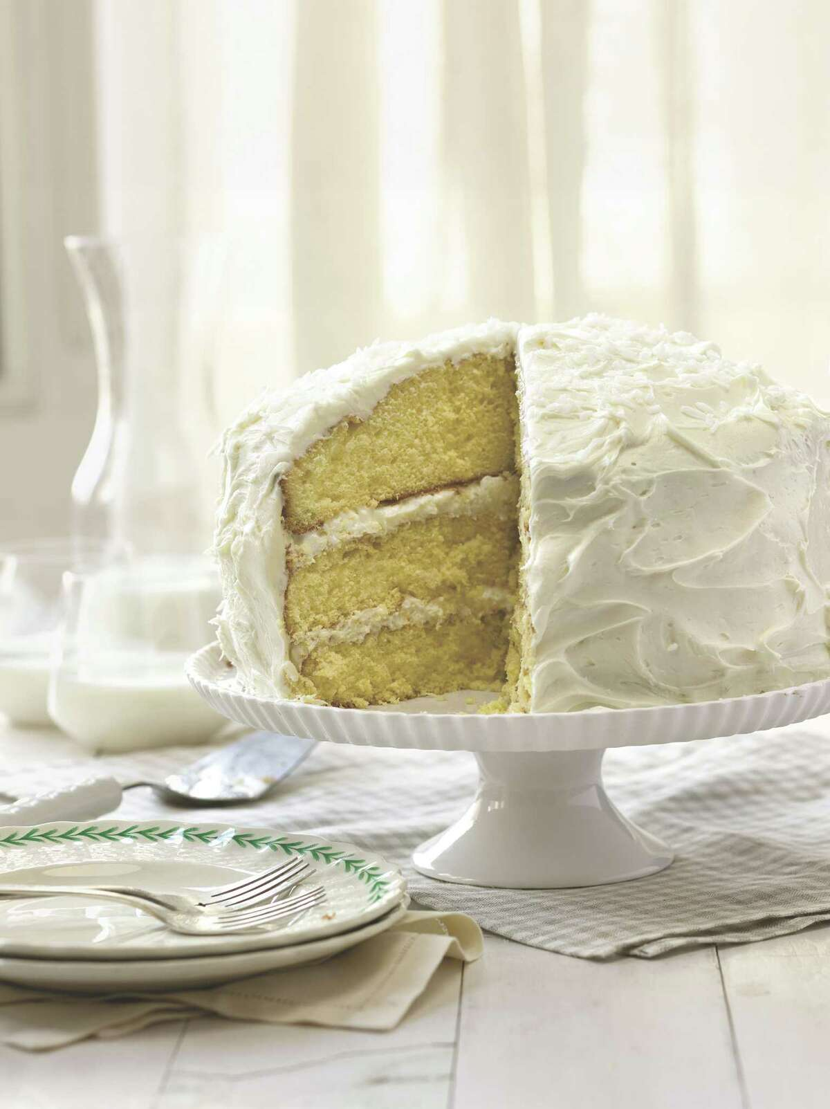 """Deen makes this three-layer Coconut Cake for her son Jamie's birthday. The recipe is included in the """"Southern Cooking Bible"""" by Paula Deen with Melissa Clark. Copyright 2011 by Paula Deen. Reprinted by permission of Simon & Schuster, Inc, NY."""