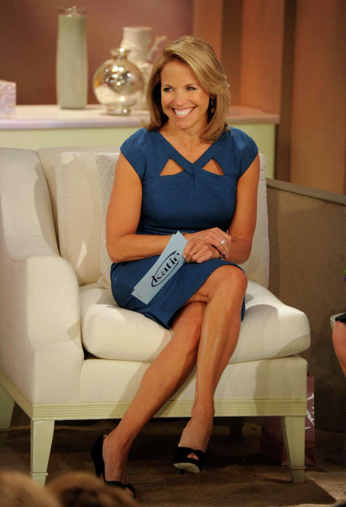 """This image released by ABC shows host Katie Couric making her debut appearance for her syndicated talk show """"Katie,"""" Monday, Sept. 10, 2012 in New York. (AP Photo/Disney-ABC Domestic Television, Ida Mae Astute)"""