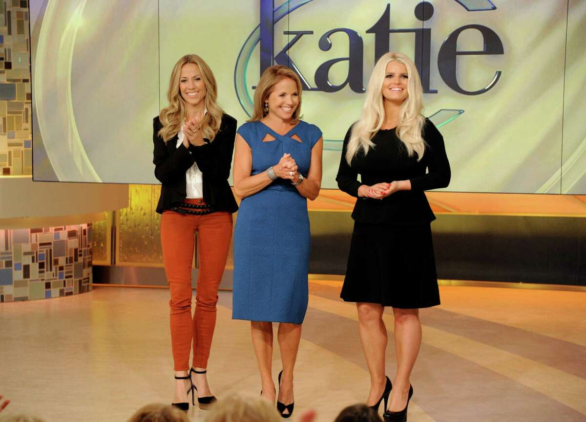 """This image released by Disney-ABC Domestic Television shows host Katie Couric, center, with celebrity guests Sheryl Crow, left, and Jessica Simpson on the premiere episode of her new syndicated talk show """"Katie,"""" Monday, Sept. 10, 2012, in New York. (AP Photo/Disney-ABC Domestic Television, Ida Mae Astute)"""