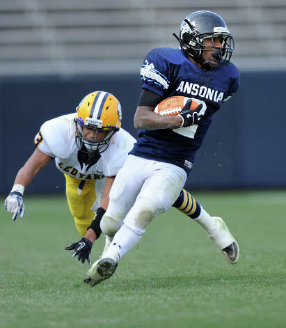 Ansonia's Arkeel Newsome shakes off Ledyard's William Finney Saturday, Dec. 10, 2011 during the Class M State Championship football game at Rentschler Field in East Hartford, Conn. Photo: Autumn Driscoll / Connecticut Post