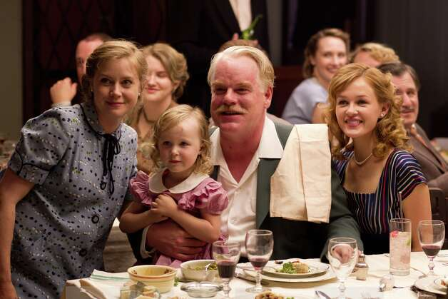 "This film image released by The Weinstein Company shows Amy Adams, left, and Philip Seymour Hoffman, center, in a scene from ""The Master.""  The film will be presented at the 37th Toronto International Film festival running through Sept. 16. (AP Photo/The Weinstein Company) Photo: Associated Press / The Weinstein Company"