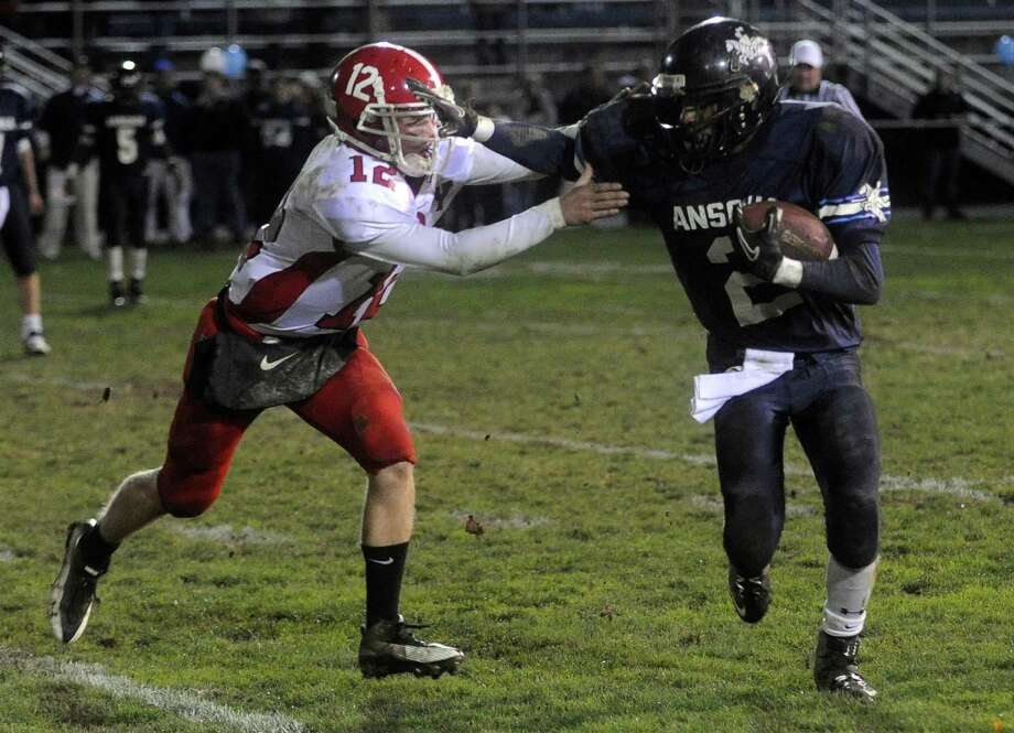 Arkeel Newsome of Ansonia is tackled by Jonathon Haydu of Derby during Friday's game at Jarvis Field in Ansonia on October 29, 2010. Photo: Lindsay Niegelberg, ST / Connecticut Post