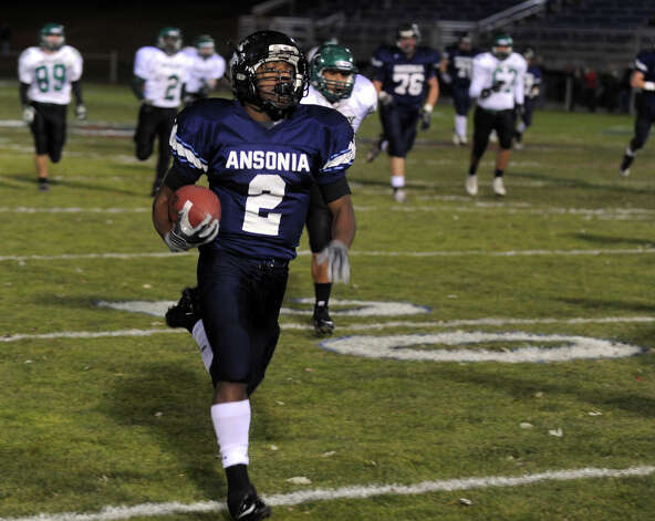 A look at the Ansonia football program and the multi-generational reach it has, during a recent game against Wilby in Ansonia, Conn. on Friday November 11, 2011. Ansonia's #2 Arkeel Newsome carries the ball into the endzone for a touchdown. Photo: Christian Abraham / Connecticut Post