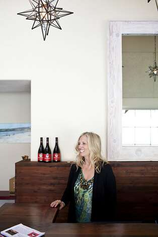 Dawn Galante works in the recently opened tasting room of her Dawn's Dream Winery. Photo: Jason Henry, Special To The Chronicle