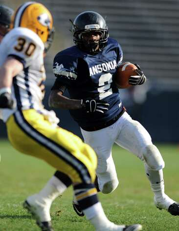 Ansonia's Arkeel Newsome looks to avoid Ledyard's Alex Manwaring Saturday, Dec. 10, 2011 during the Class M State Championship football game at Rentschler Field in East Hartford, Conn. Photo: Autumn Driscoll / Connecticut Post