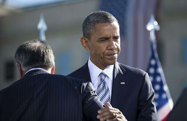 President Obama walks past Defense Secretary Leon Panetta at the 9/11 Pentagon memorial. Photo: Carolyn Kaster, Associated Press