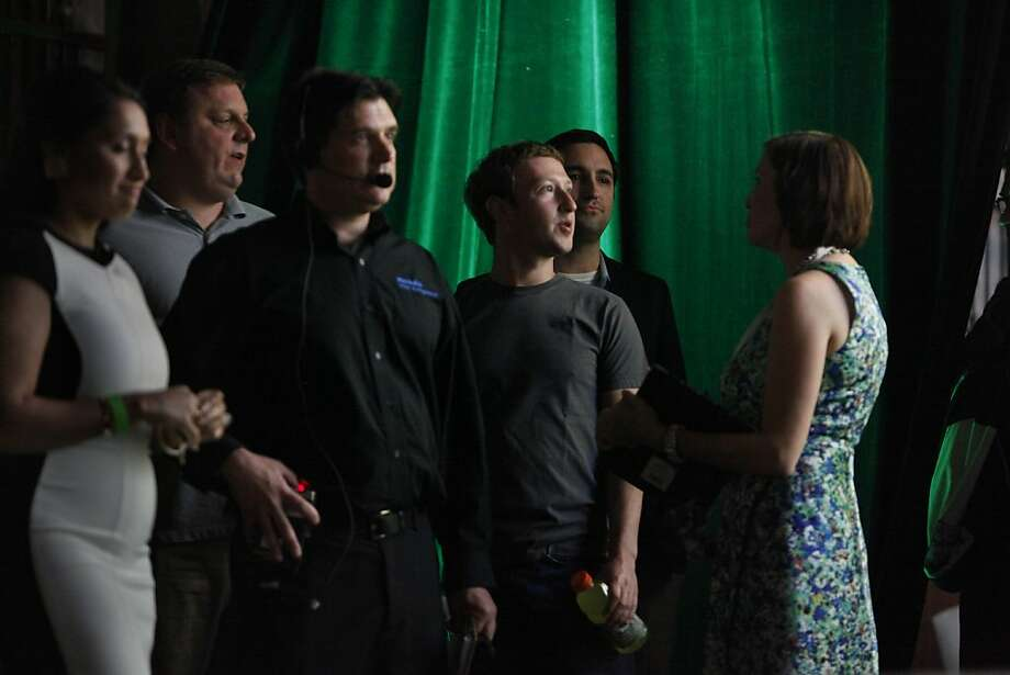 Michael Arrington (second from left), heads to the stage with Mark Zuckerberg (gray T-shirt). Photo: Lea Suzuki, The Chronicle