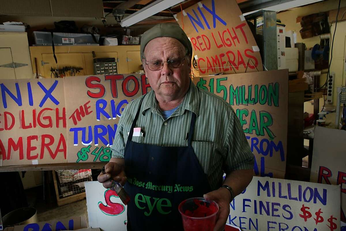 Roger Jones making protest signs in his basement at home in Fremont, Calif., Friday, February 3, 2012. California's red light camera citations are the most expensive in the world ($480), and a new group in Fremont is dedicated to reducing them. He often goes to the Fremont courthouse to advise those with redlight tickets.