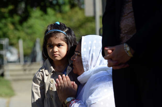 Zahra Moosani, 4, stands with her mother, Sobieh, of Stamford, during a moment of silence during the Stamford Fire & Rescue Department (SFR) and the Stamford Professional Fire Fighters Association 9/11 Memorial Observance in front of Station 5 on Washington Blvd. in Stamford on Tuesday, Sept. 11, 2012. Photo: Amy Mortensen / Connecticut Post Freelance
