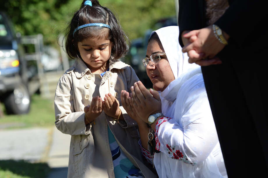 Zahra Moosani, 4, stands with her mother, Sobieh, of Stamford, during the Stamford Fire & Rescue Department (SFR) and the Stamford Professional Fire Fighters Association 9/11 Memorial Observance in front of Station 5 on Washington Blvd. in Stamford on Tuesday, Sept. 11, 2012. Photo: Amy Mortensen / Connecticut Post Freelance