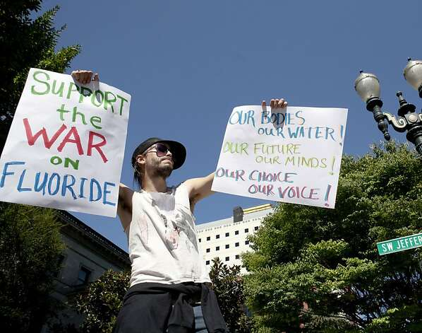 China Starshine demonstrates outside Portland City Hall on Sept. 6 against the fluoride effort. Photo: Ross William Hamilton, Associated Press
