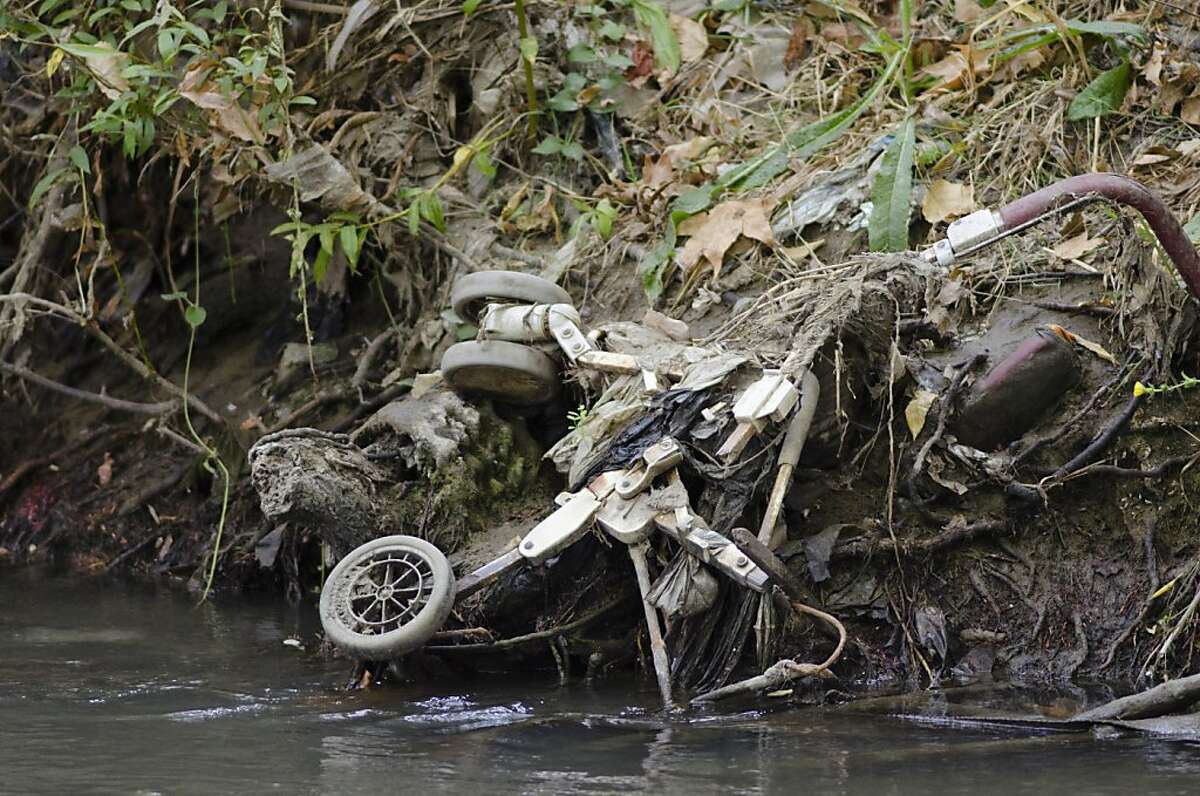 A large patch of garbage floats across Coyote Creek in San Jose on Sept. 11th, 2012.