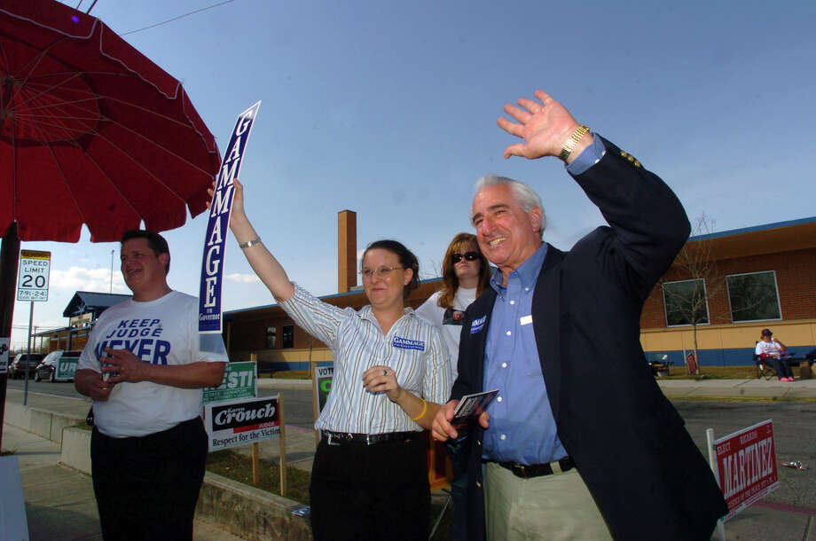 Democratic gubernatorial candidate Bob Gammage (rt.) waves to passers by at Price Elementary school during primary elections. Standing with Gammage are Judge Phil Meyer (L), Nicole Mahler and Katy Cutright. JOHN DAVENPORT / STAFF Photo: JOHN DAVENPORT, SAN ANTONIO EXPRESS-NEWS / SAN ANTONIO EXPRESS-NEWS