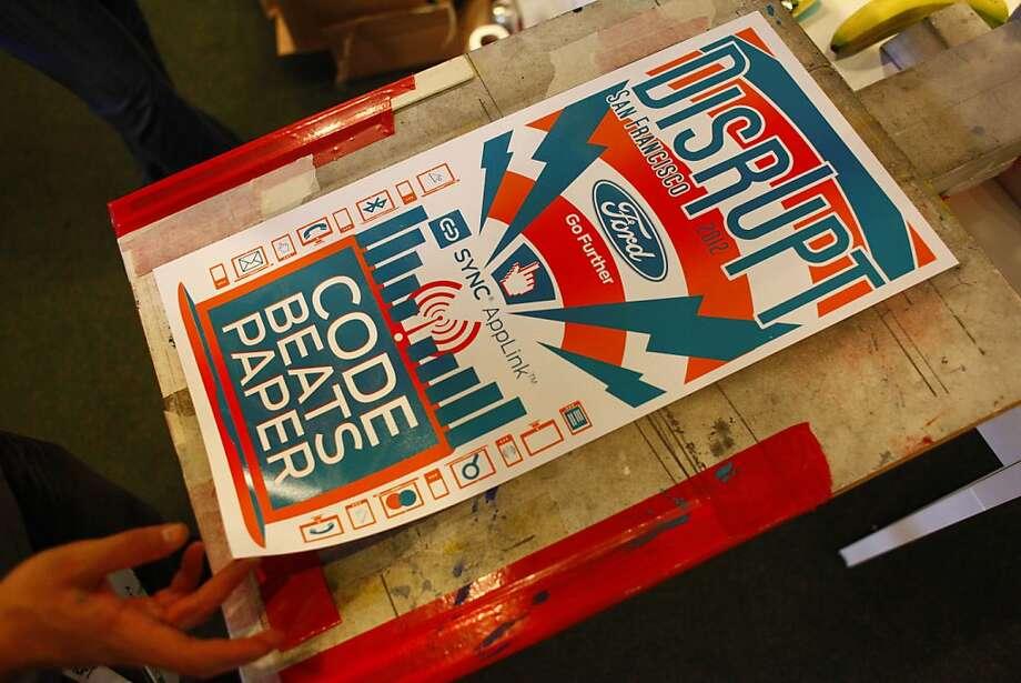 Caleb Barton makes posters at the TechCrunch Disrupt conference. Photo: Lea Suzuki, The Chronicle