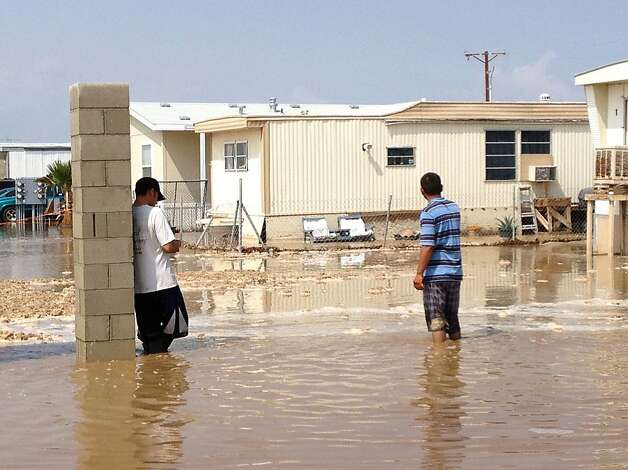 Water is nearly knee deep in a mobile home park in Mecca. The town also had some flooding at an elementary school. Photo: Denise Goolsby, Associated Press