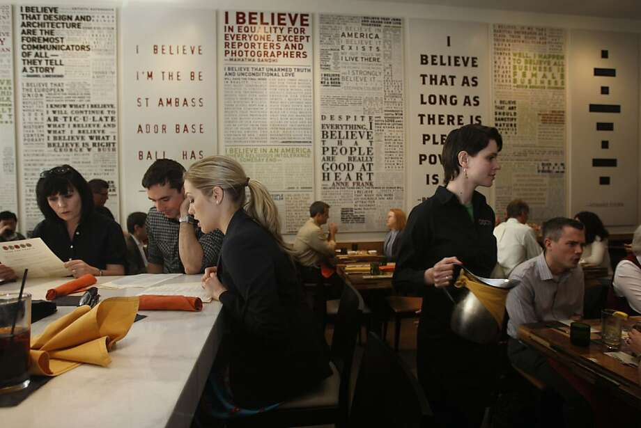 Famous quotes about beliefs cover the walls at Credo, a popular restaurant in the Financial District that sometimes struggles with food and service. Photo: Liz Hafalia, The Chronicle