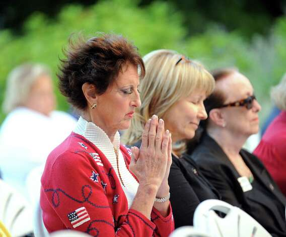 Cindy Castronovo of Greenwich prays during the 9/11 remembrance ceremony at Greenwich Town Hall, Tuesday night, Sept. 11, 2012. Photo: Bob Luckey / Greenwich Time