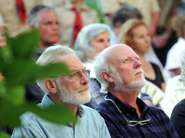 Michael Jones, right, of Greenwich, looks skyward during the 9/11 remembrance ceremony at Greenwich Town Hall, Tuesday night, Sept. 11, 2012. Photo: Bob Luckey / Greenwich Time
